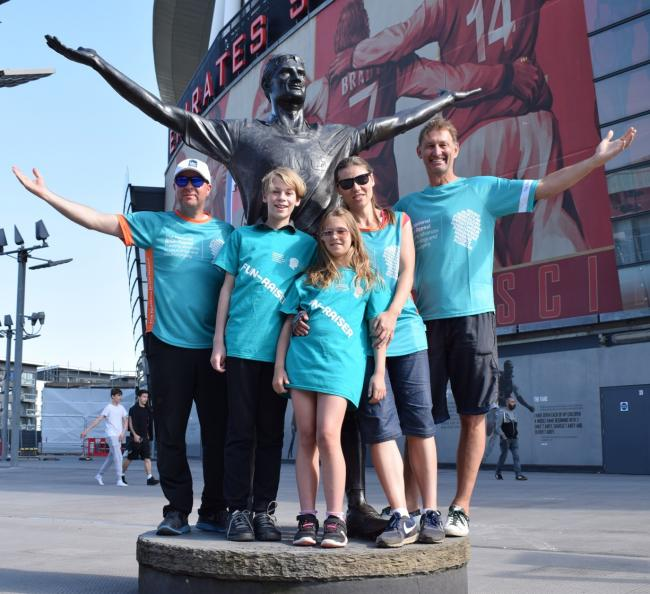 Walk on: Lewis and family with Tony Adams at the Emirates