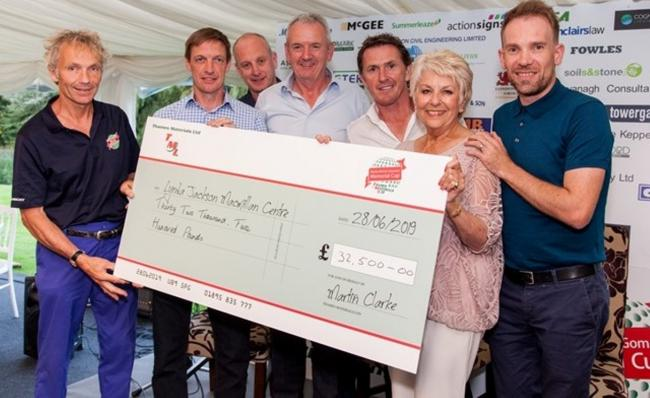 Cheque that out: golfers raised £32,000
