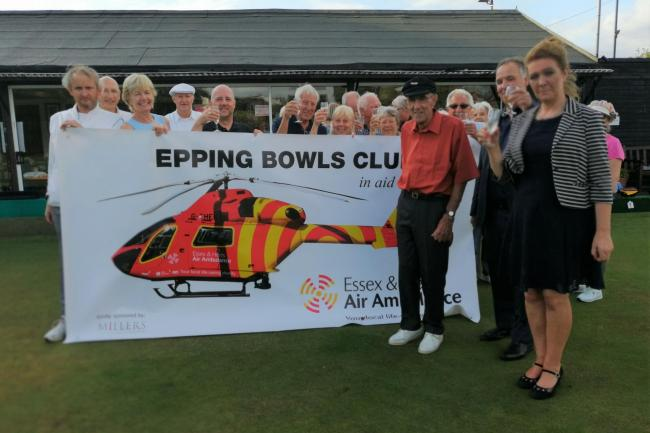 Members of Epping Bowls Club and Essex & Herts Air Amublance team