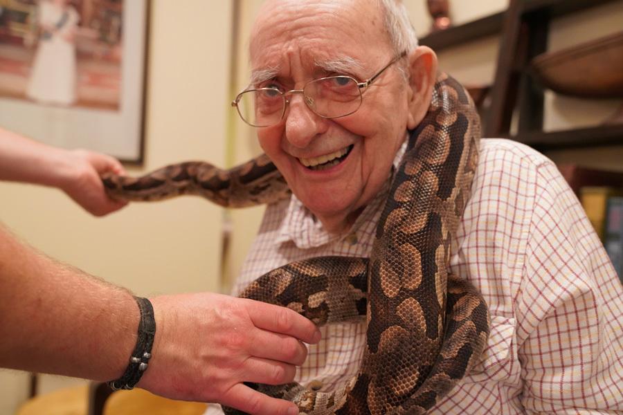 Surbiton veterans get up close to creepy crawlies during visit from zoo