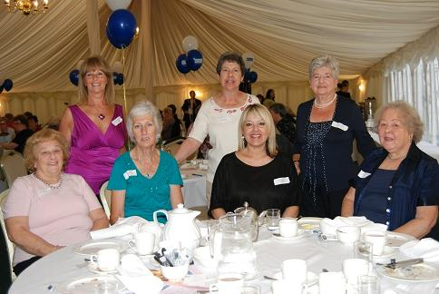 Volunteers from the South Woodford branch enjoy their party.