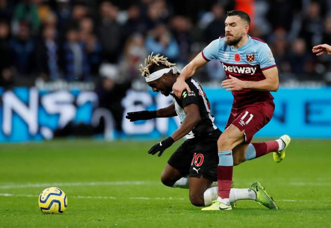 Robert Snodgrass tangles with Allan Saint-Maximin. Picture: Action Images