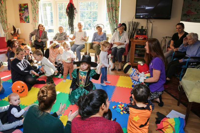 Youngsters from Tiny Talk baby singing class wore colourfukl Halloween outfits to show Woodland Grove care home residents