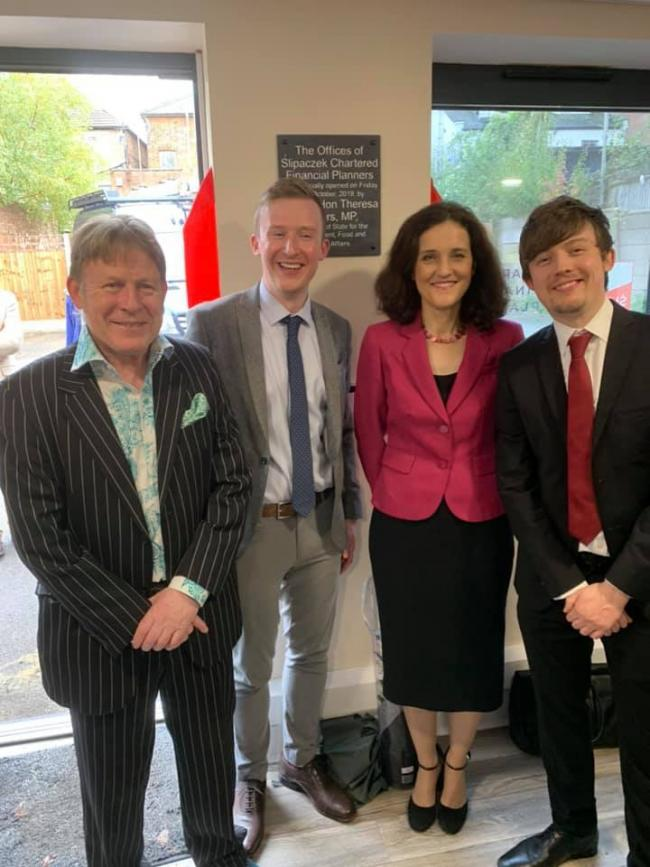 Filip Slipaczek, left, pictured with his sons and Theresa Villiers. Photo credit: Roger Aitken
