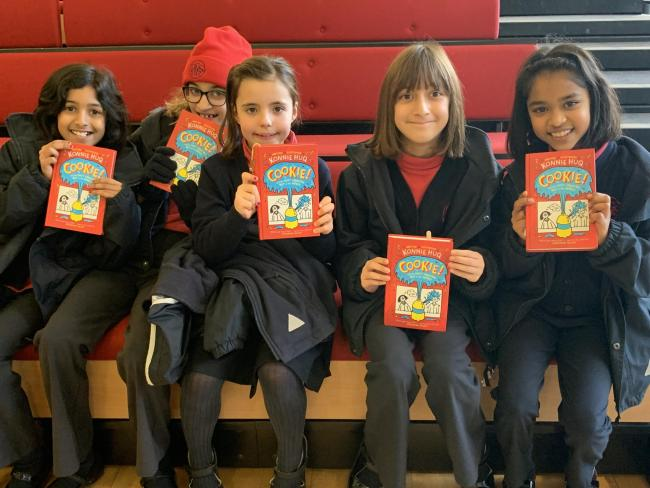 Devotees: young pupils enjoy their time with Konnie Huq
