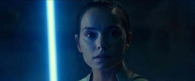 Rey holding a lightsaber in Star Wars: The Rise of Skywalker
