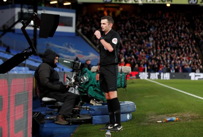 Michael Oliver sent off Luka Milivojevic after using the monitor. Picture: Action Images