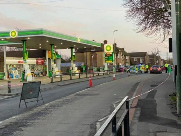 Pictures taken by Graham Fox show police at the scene outside the BP service station