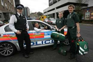 Partners: PC Robin Birch, left, with PC Adam Stephens, and paramedics Charlotte Coutts and Stephen Bryant