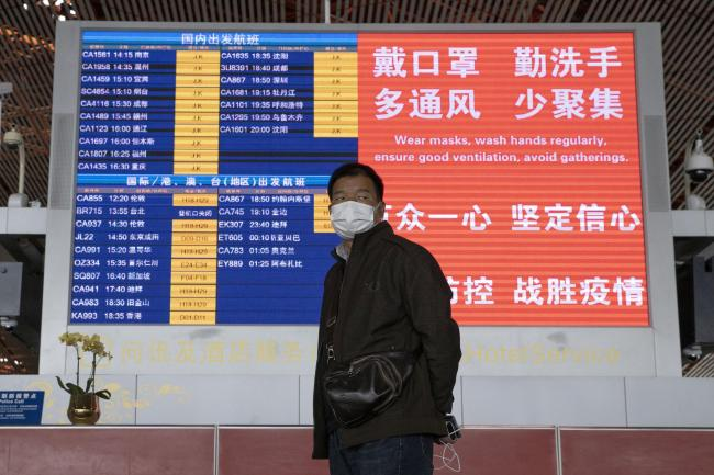 China is temporarily barring most foreigners from entering the country