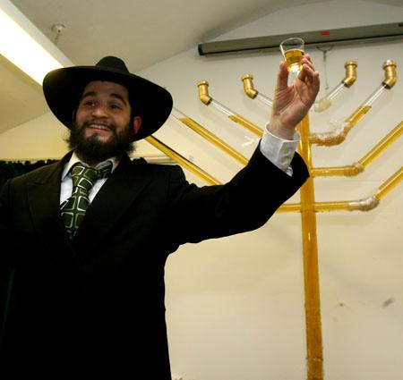 Rabbi Odom Brandman unveils the worlds first Whisky menorah