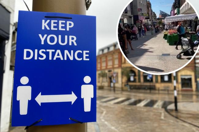 New social distancing signs posted across Bromley's town centres, while (inset) hundreds flock to Bromley Primark on Monday. Inset image: Emilios Shavila