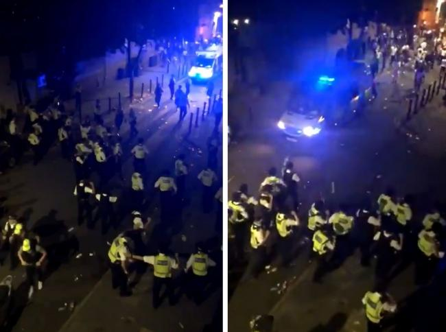 Screen grab from Twitter footage showing police clash with a crowd in Brixton Wednesday night. Image: PA/Twitter