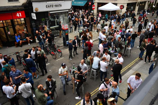 Drinkers in Soho, London, as coronavirus lockdown restrictions are eased across England. This follows the latest Covid-19 cases for England, showing the latest south east London Covid-19 rates and a drop in hospital admission in London. Victoria Jones/PA