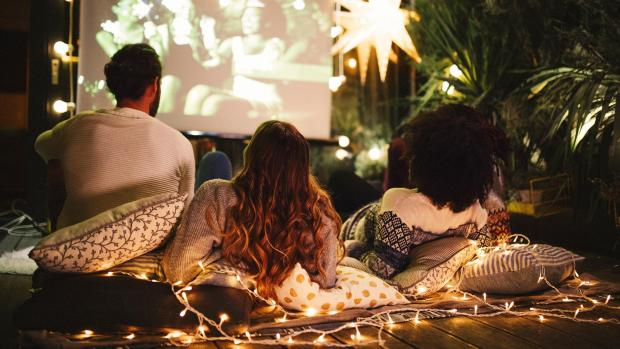 This Is Local London: Sit back and relax with a projector and outdoor screen. Credit: Getty Images / M_A_Y_A