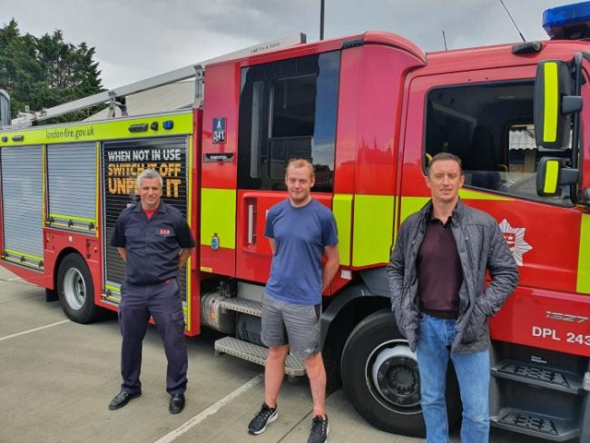 Brian Mottram, centre with firefighters Billy Merrifield, left, and Simon Cullen, right. Credit: London Fire Brigade