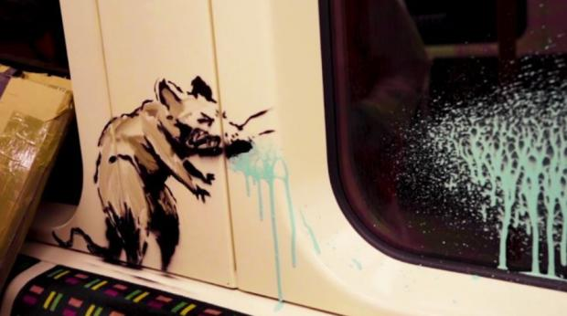 This Is Local London: Banksy's sneezing rat reminds us of the dangers of passing on the virus on public transport (Photo: Banksy).