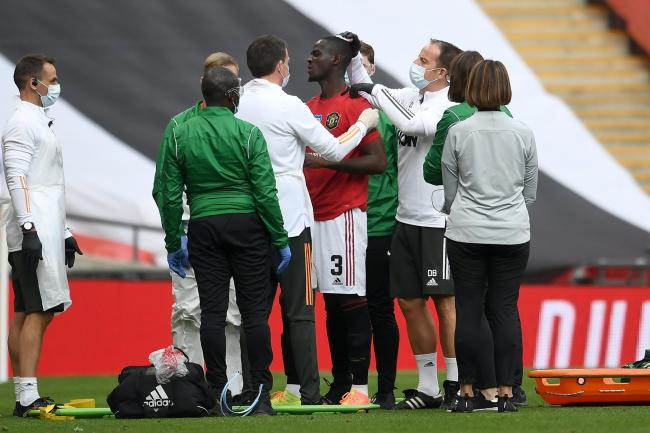 Manchester United's Eric Bailly receives treatment for a head injury