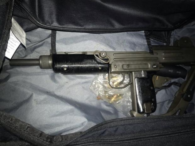 This Is Local London: Gun found in the bag with a silencer and ammunition.