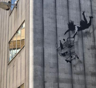 This Is Local London: Banksy's 'Falling Shopper' mural is hidden storeys above London's street level, surviving unscathed