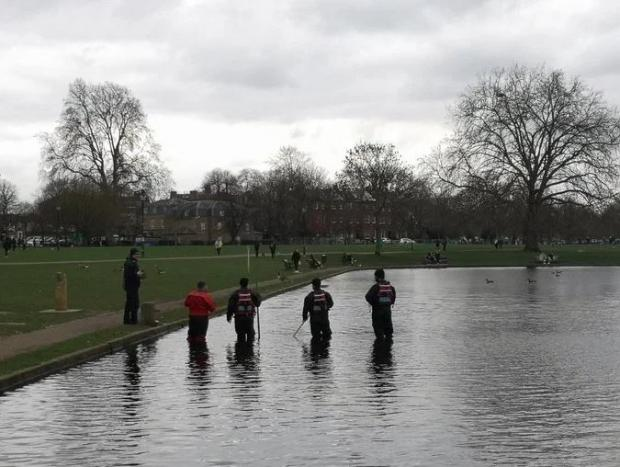 This Is Local London: Police are seen searching Clapham Common ponds todayCredit: Sky News