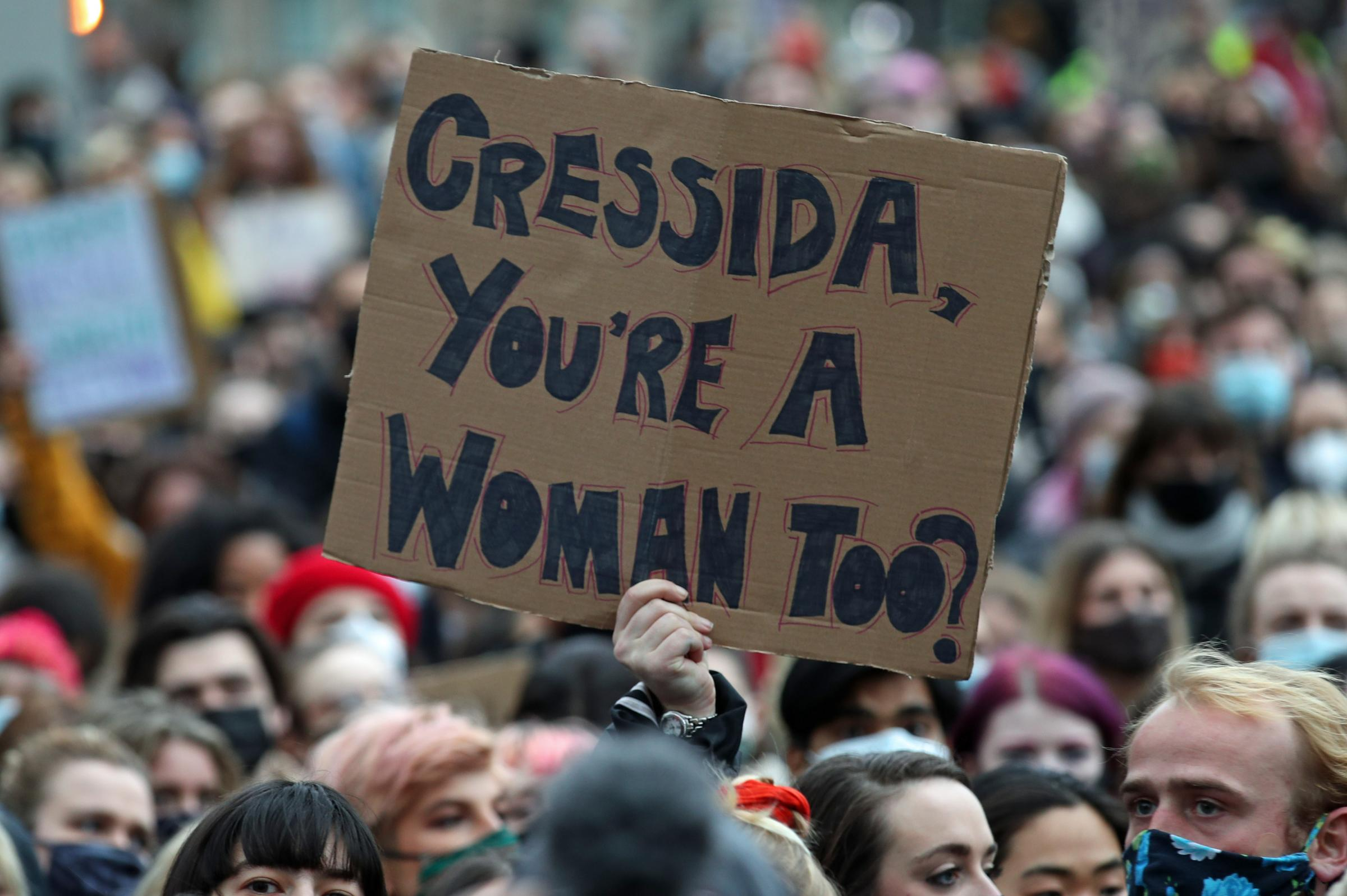 A person holds up a placard addressing Metropolitan Police Commissioner Dame Cressida Dick amongst a crowd of people holding placards in Parliament Square