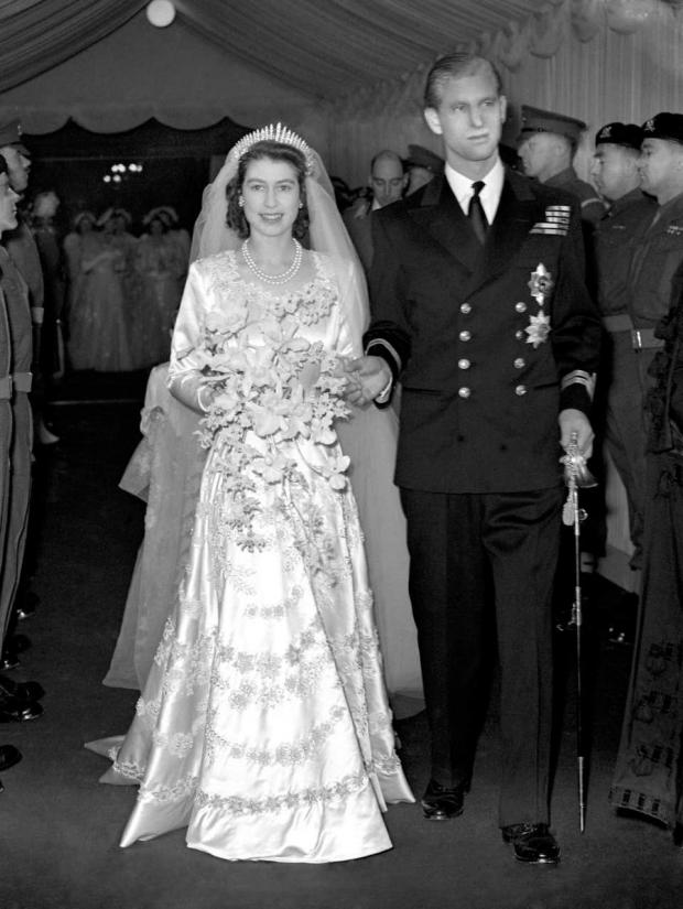 This Is Local London: Princess Elizabeth and the Duke of Edinburgh leaving Westminster Abbey after their wedding ceremony (PA)
