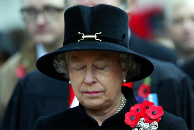 This Is Local London: The Queen sheds a tear during the Field of Remembrance Service at Westminster Abbey in 2002 (PA)