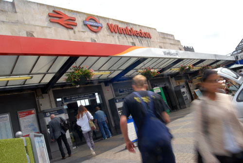 A person died after being hit by a train at Wimbledon station
