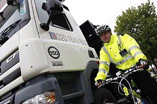Change: Cyclists were invited to get behind the wheel of a lorry in a bid to stop a spate of recent accidents.