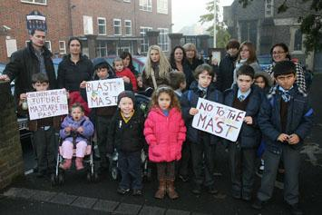 Parents and children protesting at plans for a phone mast near St Mary's Catholic Primary School in Chingford.