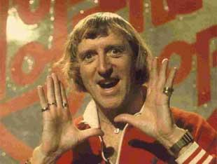 This Is Local London: NOW THEN, NOW THEN: Jimmy Savile as the presenter of the BBC's flagship pop music programme Top Of The Pops