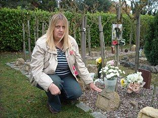 Janet Tucker at her father's grave