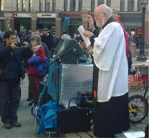 Rev Adrian Benjamin addresses protesters outside St Paul's