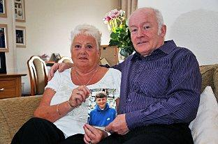 Peter and Christine Boxell with a picture of their son Lee