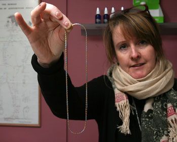 Maria Briscoe with the necklace left by thieves