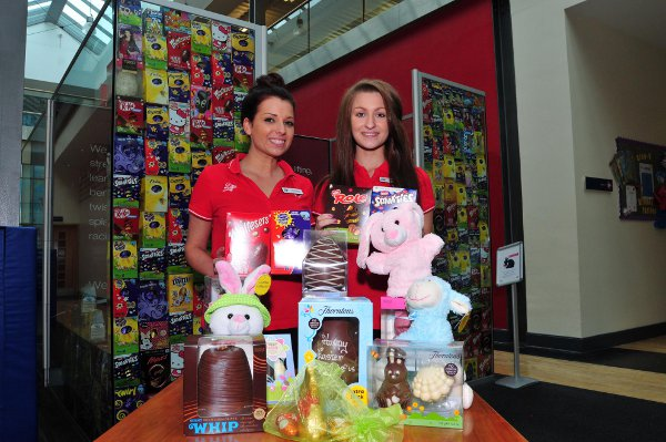 Virgin Active front of house assistants Charlotte Dawson and Hannah Robertson with the wall of eggs