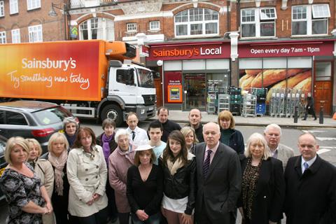 MP Iain Duncan Smith with campaigners outside Sainsbury's in The Broadway