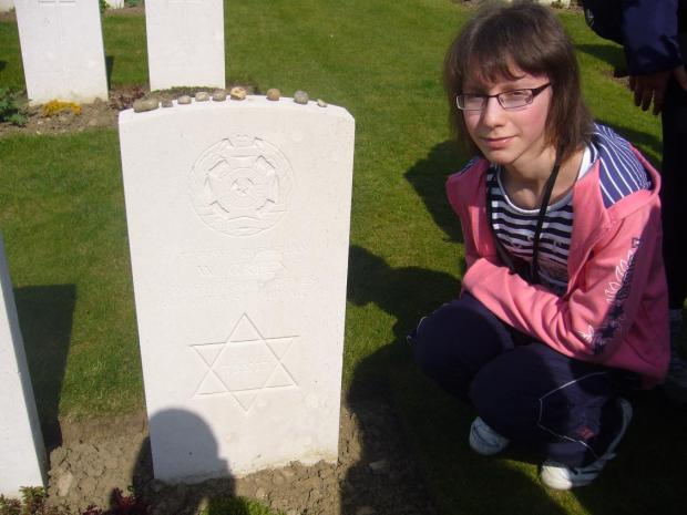 Sarah Wortman at the grave of Wolf Green in Ypres