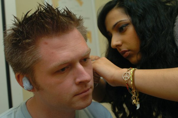 Registered hearing audiologist Kiran Kaur fills Robert Fisk's ears with a blue foam