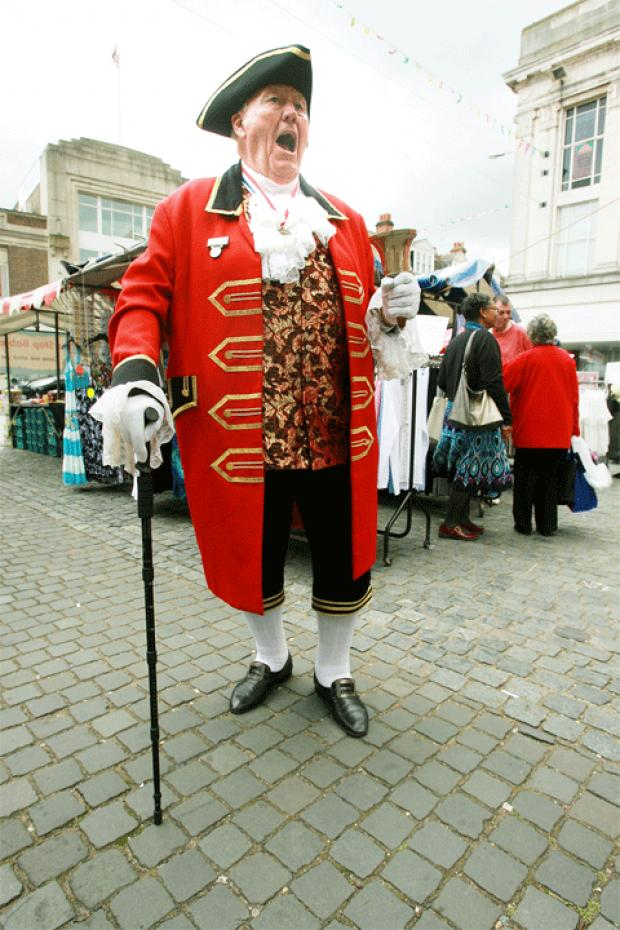 Town crier Peter Frost entertains the crowds in Church Street.