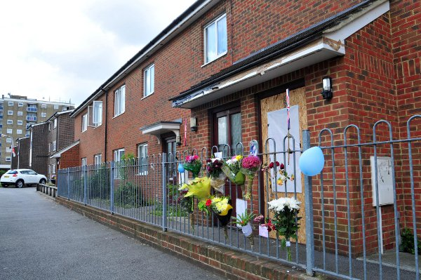 This Is Local London: Floral tributes have been left outside Mr Green's flat in Holly Court.