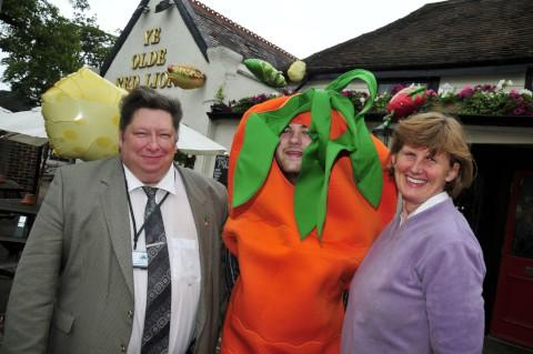 The giant carrot bumped into Cheam councillors Mary Burstow and Jonathan Pritchard