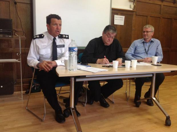Facing the people (L-R): Det Ch Supt Darren Williams (Merton police), Rev Andrew Wakefield (chairman, Merton Community Policing Partnership, and Ged Curran (chief executive, Merton Council)