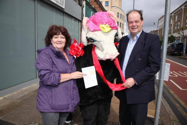 "Stephen Hammond MP and Merton Conservative Group leader Debbie Shears make their point by parading a pantomime ""cash cow"" in Hartfield Road"