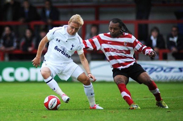 Earning his Spurs: Kingstonian winger Dean Lodge tussles with Tottenham's Alex Pritchard