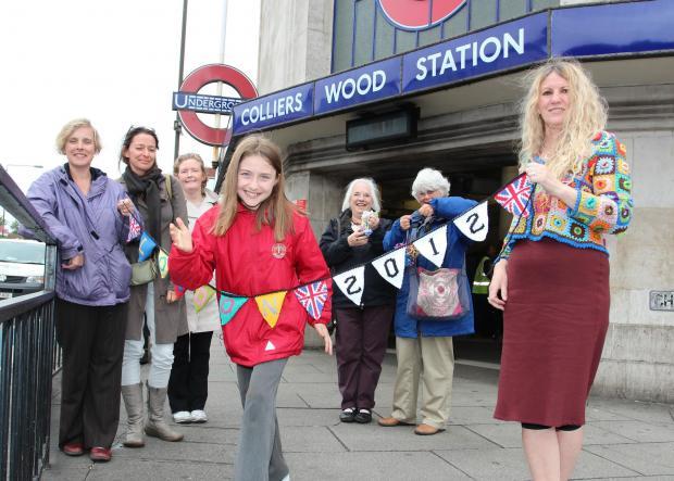 Knitters, led by 'yarnaholic' Ruth Herring (right) pledge to spruce up Colliers Wood for Olympic parade