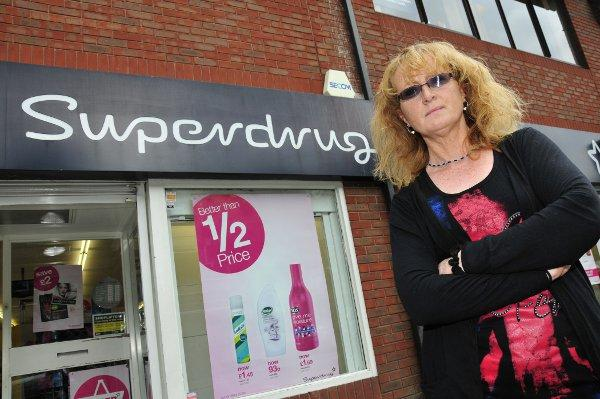 Kim McFarland was subjected to the ordeal at the Superdrug store in Banstead High Street
