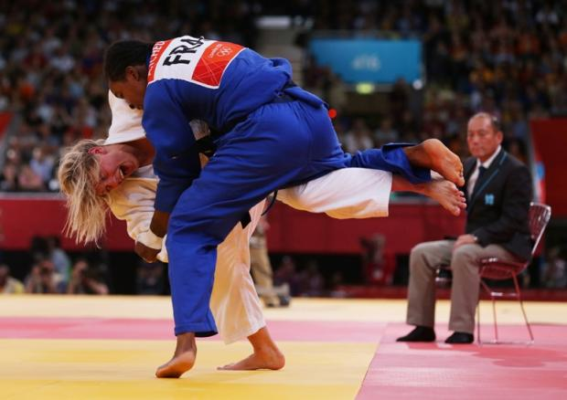 Charlton Judo player Gemma Gibbons (left) throws France's Audrey Tcheumeo to win her semi- final of Women 78 kg category at ExCel Arena (Photo: PRESS ASSOCIATION)