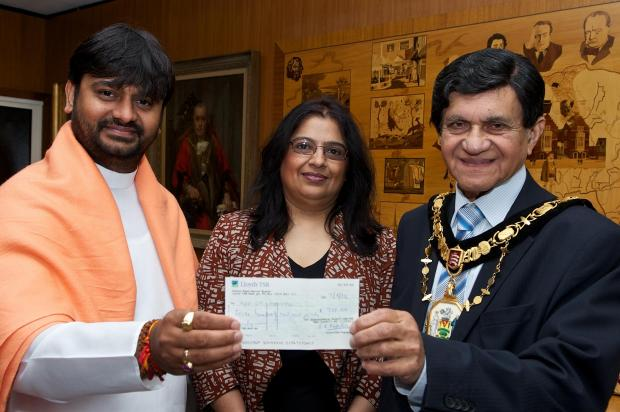 Rajesh Parmar (left), pictured in 2012 with Age UK Harrow chief executive Avani Modasia and Mayor of Harrow Nizam Ismail
